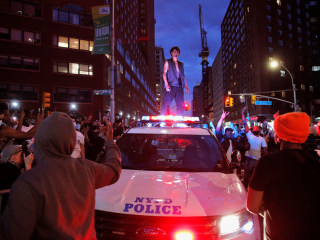 In New York, protesters clash with police as demonstrations hit cities across the country