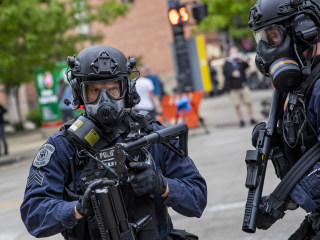 Police tip lines flooded with video of police violence, memes and K-pop