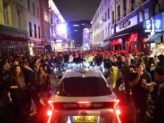 Arrests as revelers defy distancing rules after pubs reopen in England