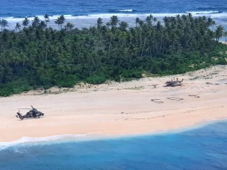 SOS in the sand: Men rescued from deserted Micronesian island