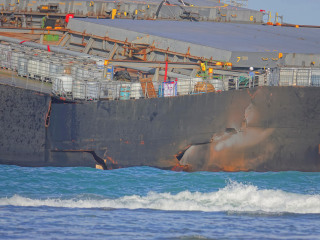 Mauritius residents join efforts to contain oil spill as grounded ship splits in two