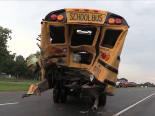 Truck driver in crash with school bus helps free trapped students before he collapses