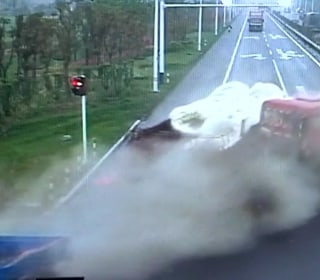 Chinese Biker Miraculously Escapes Collision With Cargo Truck
