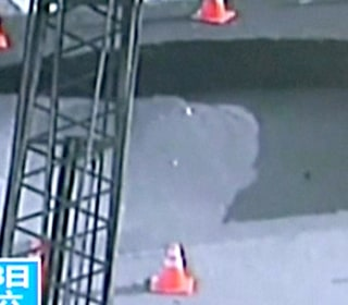 WATCH: Sharp-Eyed Cop Prevents Sinkhole From Swallowing Cars