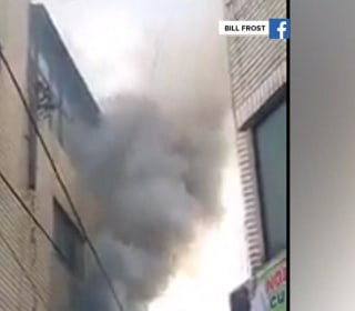 Servicemen Catch Kids Thrown From Blazing Building