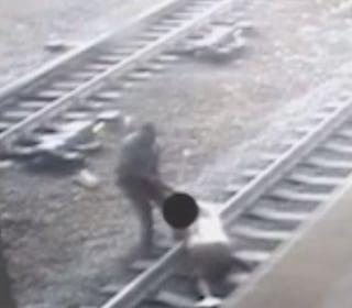 Watch: Transit Cop Pulls Man Off Track Seconds Before Train Rolls Through