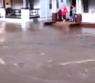 Flash Flooding Turns Suburban Street Into Raging River