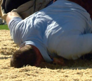 Watch Swiss Wrestlers Rumble on Sawdust Pits