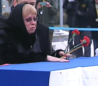 Widow's Grief as Slain Ambassador is Returned to Russia