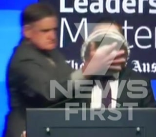 Airline Chief Gets Custard Pie in the Face as He Gives Speech