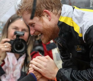 Prince Harry Recognizes, Hugs 97-Year-Old Fan Who Waited in the Rain