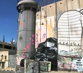 Trump Hugs Separation Wall in West Bank Mural