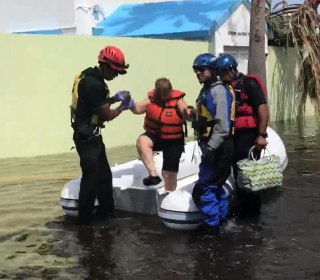 70,000 in Puerto Rico urged to evacuate towns with dam failure 'imminent'