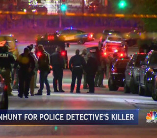 Baltimore officer shot dead as city battles rising murder rate