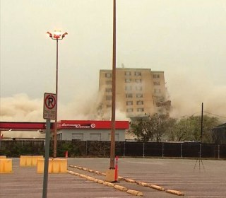Watch a 12-story building get imploded by 300 pounds of dynamite