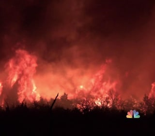 Wildfires rage in several states with homes destroyed, neighborhoods at risk