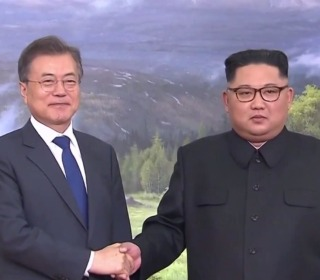 Leaders of North and South Korea meet in surprise summit
