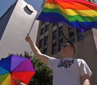 Ohio LGBTQ community holds dance party protest at Pence speech venue