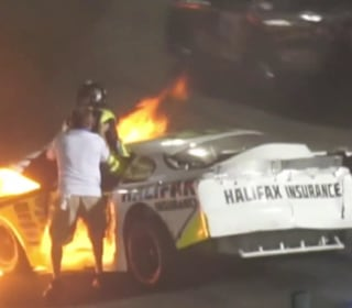 Father pulls son from burning car after dramatic racetrack crash