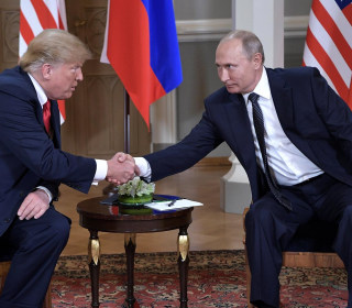 Trump and Putin sit down for face-to-face talks