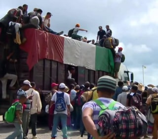 U.S. troops arrive at border with migrant caravans hundreds of miles away