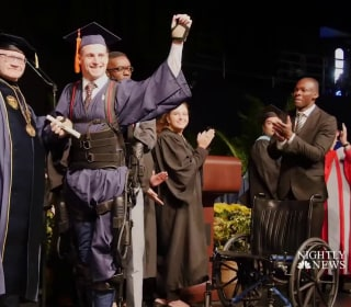 Paralyzed student walks to get college diploma