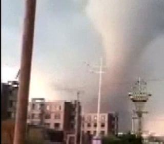 Caught on camera: Deadly tornado tears apart industrial city in China