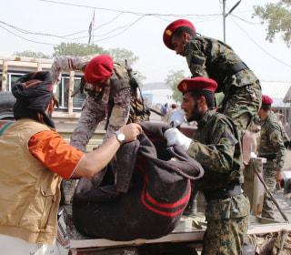 Dozens dead after suicide attacks, Houthi missile strike on Yemen parade
