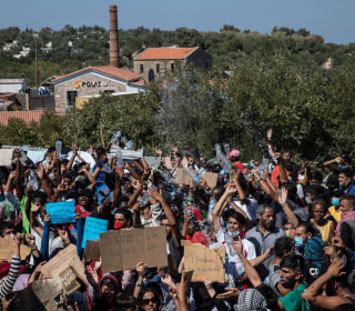 Thousands protest on Greek island Lesbos after migrant camp destroyed by fire