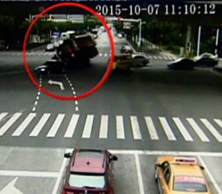 Wow That's Close! Bike Rider Has Narrow Escape as Truck Tips Over