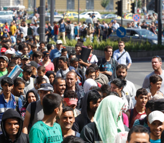 Tired of Waiting, Hundreds of Migrants Start to Walk to Austria