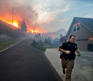 Washington Wildfire Consumes Homes and Businesses