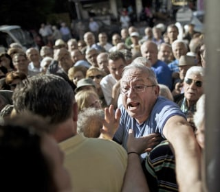 Greek Crisis: Chaos As Retirees Mob Banks to Withdraw Cash