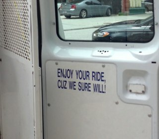 Baltimore Investigates 'Enjoy Your Ride' Sign Found in Police Van