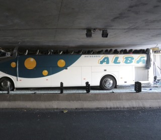 34 Injured When Low French Bridge Shears Off Top of Tour Bus