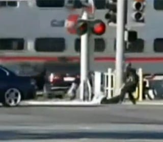 WATCH: Driver Pulled to Safety From Car Stuck on Tracks