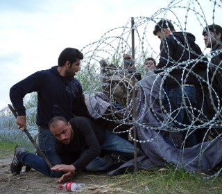 Hungary Builds Fence Amid Migrant Crisis, but Flow Continues
