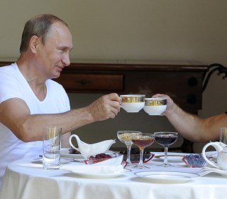 New Photos Show Russian President Putin and PM Working Out, Grilling Meat, Drinking Tea