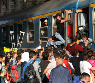 Migrants Storm Train After Police Withdraw From Budapest Station