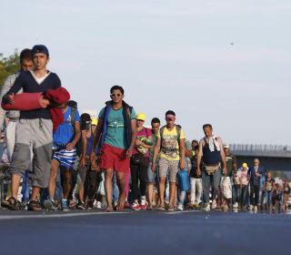 Tired of Waiting, Migrants Set off on 300-Mile Trek