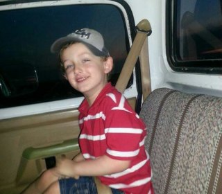 Slain Boy's Father Says Officers Shot Them Without Warning