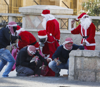 Palestinian Santas Clash With Israeli Soldiers