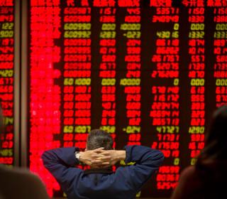 China Shares Turn Higher After Wild Start to 2016