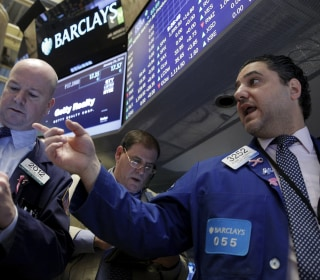 Dow Halves Losses As Energy Stocks Attempt Rally
