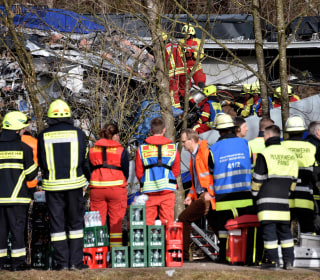 Trains Collide in Bad Aibling, Germany, Killing Nine and Injuring 150