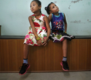 Two Girls, One Pair of Shoes: Nepal Earthquake Victims Bond