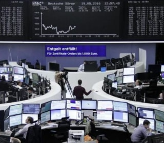 Global Stocks See-Saw, Yields Slip as Investors Get Week Off to Cautious Start