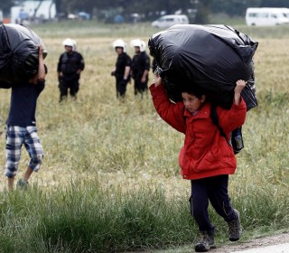 Stranded Refugees Evacuated from Greek Border Camp