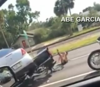 Car Runs Over Couple's Motorcycle in Shocking Road-Rage Caught on Video