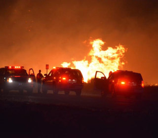 2 Killed, Dozens of Homes Burn in Growing California Wildfire